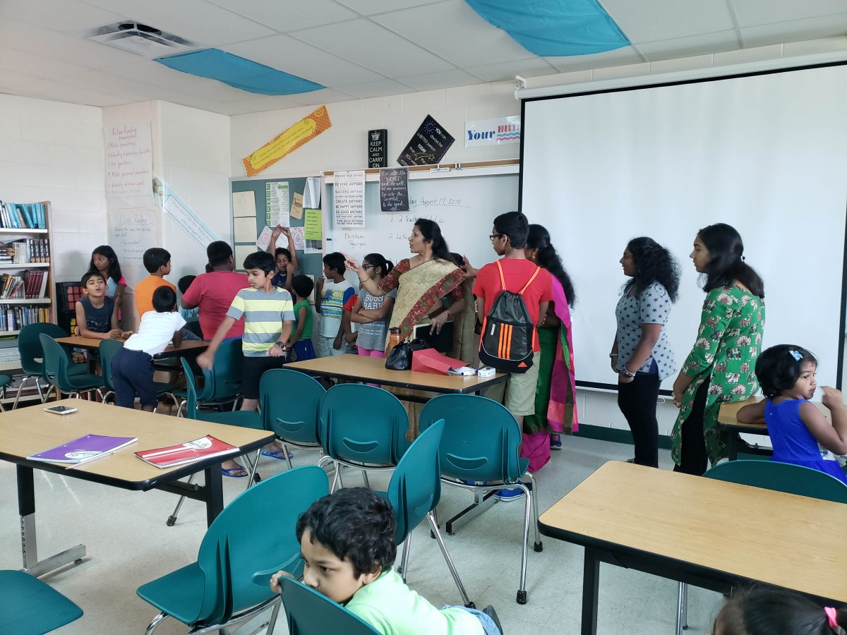 2018 - Subhadra Suresh and Pooja Ramachandran evaluating the kids for class placement